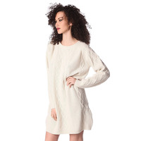 Cream sweater dress in chunky knit with cable stitch details
