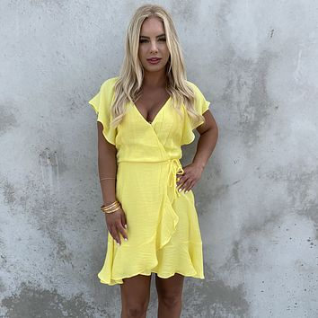 Caught My Eye Wrap Dress in Yellow