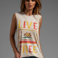 The Laundry Room Live Free CA Lightening Wash Muscle Tee in Nude from REVOLVEclothing.com