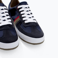 Plimsoll with colored stripes