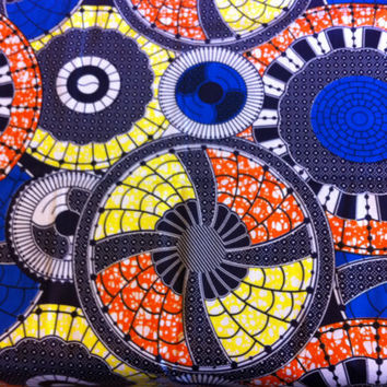 African Wax Print Fabric by the HALF YARD.  Medallions of yellow, royal blue and orange.