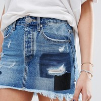 One Teaspoon Mini Skirt with Patches and Raw Hem at asos.com
