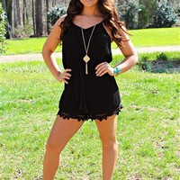 Spaghetti strapped romper that has a crochet detailing throuhgout.