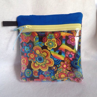 """Vinyl see through padded zippered case is versatile and is 7 1/2"""" x 7 3/4"""". Black cotton material with bright circles in various colors."""