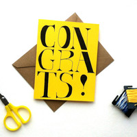 CONGRATS! Oversized thick black lettering on yellow blank card. Send congratulations to grads, newlyweds, new hires, new parents, etc.