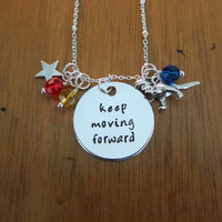 """Robinsons inspired """"keep moving forward"""" necklace. T-Rex. Inspirational quote. Silver colored, Swarovski Elements crystals."""