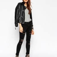 ASOS PETITE Whitby Low Rise Skinny Jeans In Washed Black With Rip And Destroy Busts