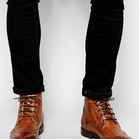 ASOS | ASOS Brogue Boots in Leather With Shearling Look Lining at ASOS