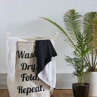 Wash, Dry, Fold, Repeat Laundry Bag - Urban Outfitters