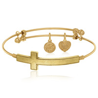 Expandable Bangle in Yellow Tone Brass with The Sideways Cross Symbol