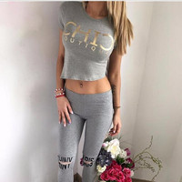 Fashion Tracksuit Women's 2 Pieces Sets Crop Tops + Long Pants Holes Elastic Waist Letter Print Asymmetrical Top Casual S6802