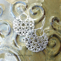 Matte silver Sterling silver filigree earrings. Engraved hearts, round hoops.