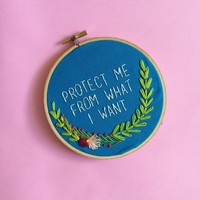 hand stitched jenny holzer truism protect me from what i want art cross stitch sign embroidery hoop design