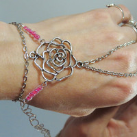 "Adjustable Flower ""Slave Bracelet"" Ring. Tibetan Silver Rose Flower accented with pink hard plastic beads. Fits wrists 6 to 8 inches."