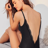 Calvin Klein Sheer Lace Low-Back Bodysuit | Urban Outfitters
