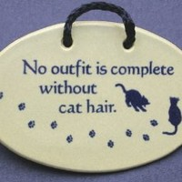 No outfit is complete without cat hair. Ceramic wall plaques and art signs handmade exclusively by Mountain Meadows Pottery in the USA.