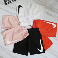 Nike pants are loose cotton casual trousers  shorts