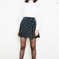 Cooperative Geo Bee Pleated Skirt at Urban Outfitters