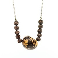 Tagua nut and carved bead necklace