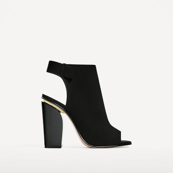 SLINGBACK LEATHER ANKLE BOOTS DETAILS