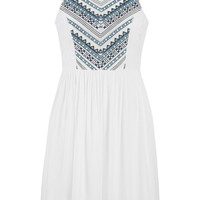 white dress with embroidery and lace