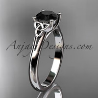 platinum celtic trinity knot wedding ring with a Black Diamond center stone CT7154