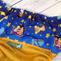 Genie Out Of The Bottle, PK (Marigold outer, two-toned snaps- Marigold caps/Royal Blue pieces) Wrap Around, OS Pocket DiaperInstock and ready to ship