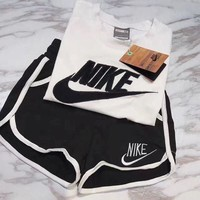 NIKE Sports Two Piece Suit Shorts Tee Shirt Women Two Piece Top Black/White