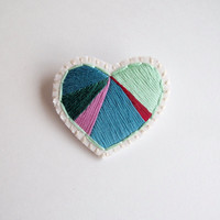 Valentines day heart brooch hand embroidered with geometric color block in emerald and mint greens with violet and red on cream muslin
