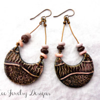 Pink and brown ceramic drop and Indonesian glass earrings.