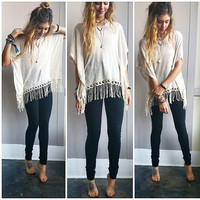 An Oatmeal and Knit Fringe Poncho Top