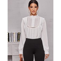 Solid Pointelle Mock Neck Blouse
