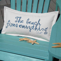 "The BEACH FIXES EVERYTHING  indoor outdoor pillow blue lettering on white background 12""x20"" handpainted coastal tides Crabby Chris Original"