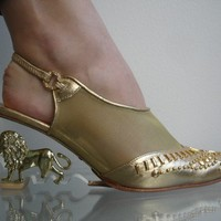 http://www.etsy.com/listing/71700145/80s-clear-lucite-wedge-gold-lion-heels