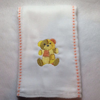 Burp Cloth with embroidered a patchwork bear in bronze, gold, and yellow. It can be personalized for an extra charge.