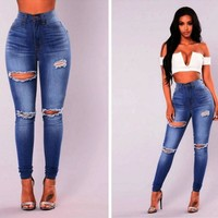 Super High Waisted Skinny Jeans: Ripped Washed Skinny Jeans