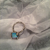 Large raw opal on a sterling silver cocktail ring with mythic claw