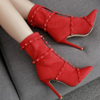 The new hot seller is studded boots with pointed leather straps