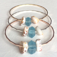 Beach glass bangle - puka shell bangle - blue sea glass bracelet - beach jewelry - bridesmaid gift .