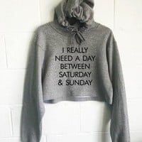 I Really Need A Day Between Saturday and Sunday Cropped Hoodie
