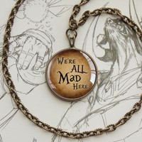 """Alice in Wonderland pendant """"We're all mad here """" quotation"""