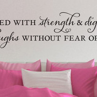 """Wall Vinyl Quote - Proverbs 31:25  - """"She is clothed with strength and dignity"""" (48"""" x 8.5"""")"""