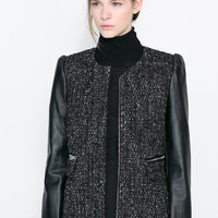 COAT WITH LEATHER SLEEVE