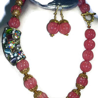 Pink Quartz Carved Beads statement necklace with a large exotic gold color pendant in rich colors