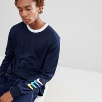 Nike SB Long Sleeve Top With Arm Print In Navy 886100-451 at asos.com