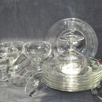 Vintage set of champagne etched glasses and serving cheese plates made in clear glass
