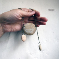 feather engraved beach pebble necklace made from sea stone of Greece