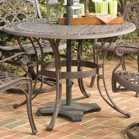 42-inch Round Patio Dining Table in Rust Brown Metal with Umbrella Hole