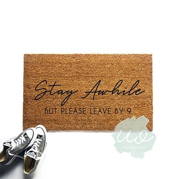 Stay Awhile But Please Leave By 9 Doormat