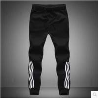 Black Street Style Joggers with Vertical Stripes along the Shins